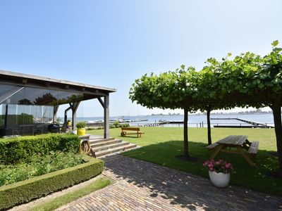 Photo for Luxury, detached villa right on the Lake Veere with your own pier.