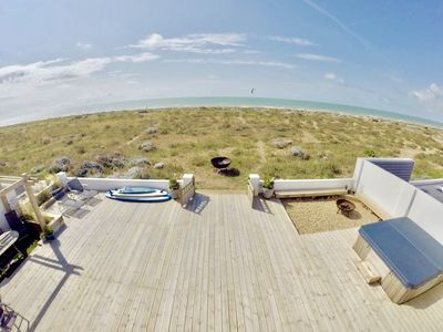 Photo for Beach House with decked garden (& hot tub) leading directly onto Shoreham Beach