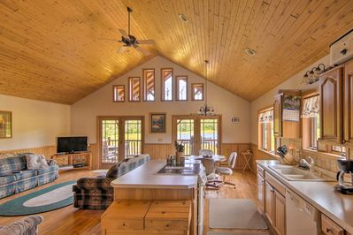 This 1,450-square-foot home offers an open floor plan, lofted space, and  wood-paneled ceilings.