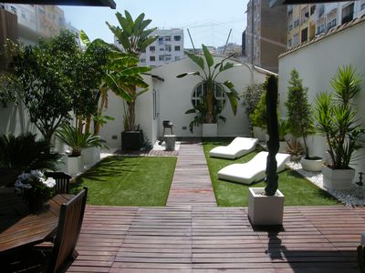 Photo for LUXURIOUS APARTMENT WITH WIFI PRIVATE SUNNY TERRACE & JACUZZI IN THE CITY CENTER