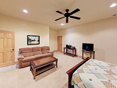 1st Bedroom - Enjoy watching movies on the flat-screen TV.