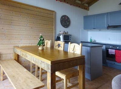 Fully equipped kitchen and dining area for 6 with authentic Savoie furniture.