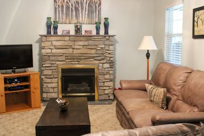 Relax in the cozy living room with flat screened TV and gas fireplace.