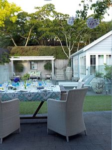 Garden with two alfresco dining areas