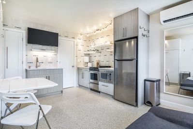 Modern efficiency with fully stocked kitchen