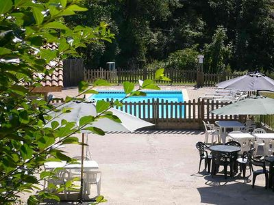 Photo for 6 Riverside Chalets with Quiet Heated Pool