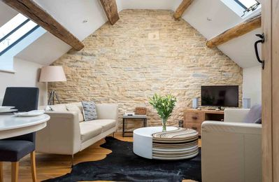 Photo for The Hayloft is a stunning apartment in the eaves of a Grade II listed barn conversion in Cold Aston