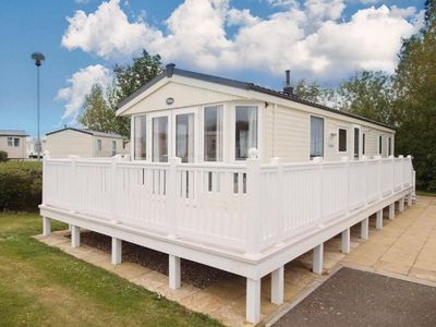 Photo for wonderful caravan for hire at Haven Hopton in Norfolk ref 80007SD