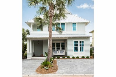 """The front of """"The Sugar Palm House"""""""