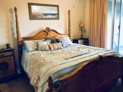Master bedroom with California King bed and flat screen TV