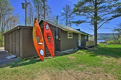 Kayaks and boats and lakes, oh my! This vacation rental home has it all.