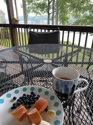 enjoy the lake view while having breakfast on the large back deck