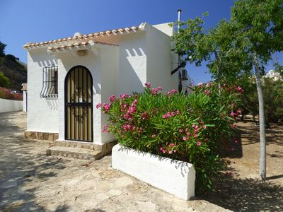 Photo for Pretty Bungalow with Pool, Private Sunny Garden, Air-Conditioning and Log Burner