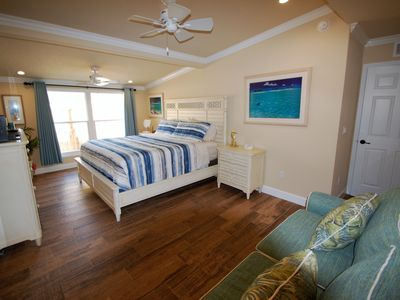 Photo for Luxurious Bahamian inspired cottage -Steps to Beach, heated pool, fully stocked!