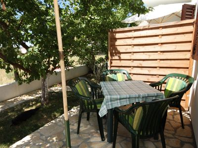 Photo for Two bedroom apartment with terrace Povljana, Pag (A-232-c)