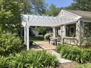 A pergola gives cover on sunny afternoons with beautiful views to the creek.