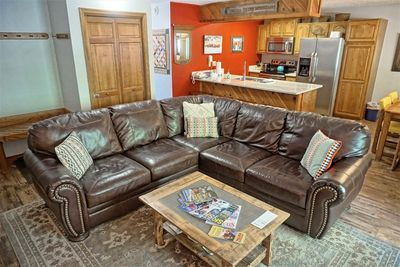 Comfy leather sofa & local information / brochures