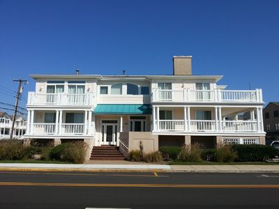 Photo for Great Summer Getaway!  1 Block to Beach, Ocean views and large wraparound deck