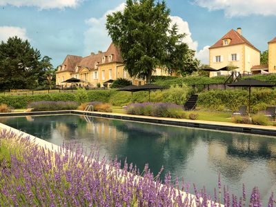 Photo for Beautiful villa with swimming pool on golf course of Château les Merles, near Bergerac