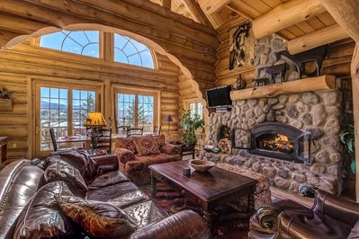 Upper Living Room with wood-burning fireplace, HDTV & DVD