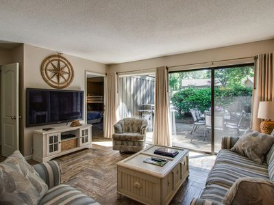 Photo for 10% Discount 8/10-8/17! Steps to pool & golf; 7 min walk to beach