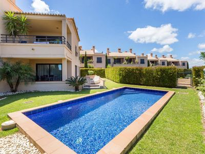 Photo for Three bedroom apartment with private garden and pool on the 5* Mar da Luz Resort