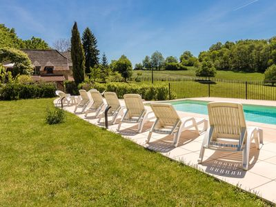 Photo for Picturesque hilltop cottage with private swimming pool and vast views