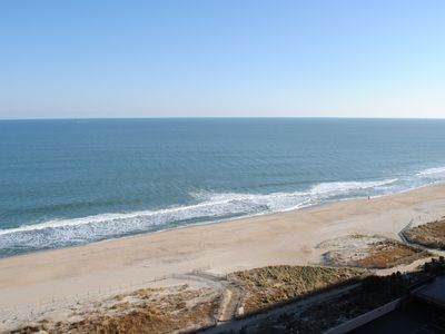 Photo for Comfortable 2 bedroom oceanfront condo popping with color that has free WiFi, an indoor pool, and a balcony with an amazing ocean view located uptown just steps to the beach!