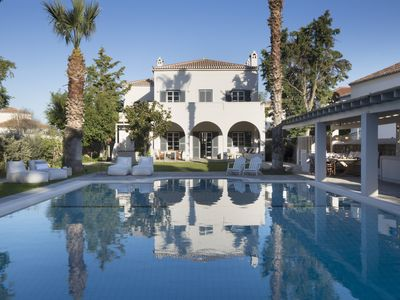 Photo for Gorgeous Mansion with Huge Swimming Pool and Basketball Court by the Beach