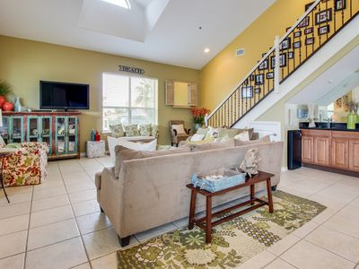 Photo for NEW LISTING! Spacious condo w/ shared pool, hot tub - one block to the beach