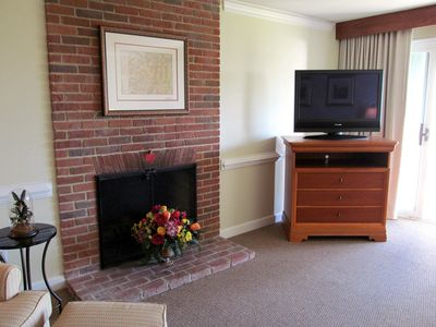 A wood burning fireplace can be enjoyed in the living, dining and kitchen area.