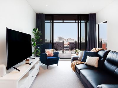 Photo for Luxe Apartment Five Minutes From Airport and City