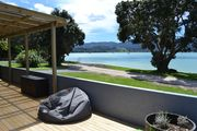 Beach Front Bach in Stunning Private Bay