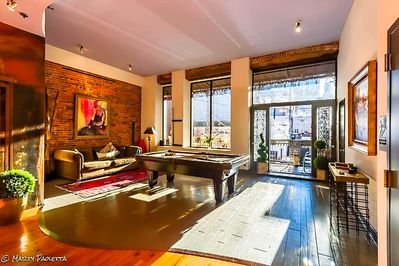 Large balcony overlooking Printers Alley with a Pool table
