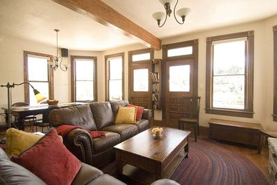 2nd Level - Cozy living room with leather couches, fireplace and mountain views