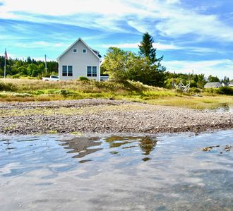 Photo for ROCKY COAST BEACHFRONT COTTAGE.  Perched Directly on a Working DownEast Harbor