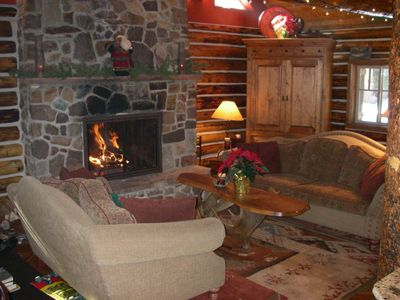 Living room with 2 story fireplace. The armoire has lots of games and a TV