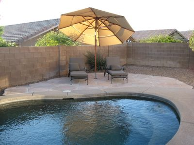 Chaise lounges by pool.  520-979-5938 for special promotions.