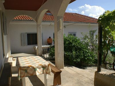 Photo for One bedroom apartment with terrace and sea view Stanići, Omiš (A-1027-c)