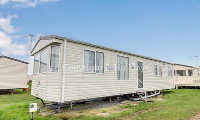Photo for Great seaside holiday home in Norfolk sleeping 8 guests ref 50052G