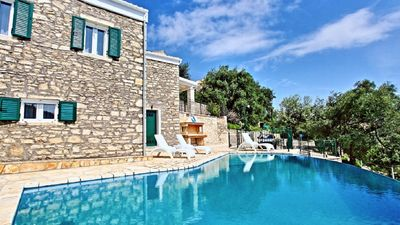 Photo for Modern stone villa with infinity pool