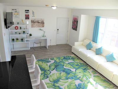 Photo for 20 min to Midtown! Modern NYC Condo 14 Beds sleeps 15 close to bus, train  ferry