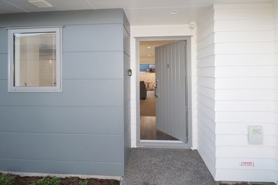 Front door entrance into open plan kitchen, dining and lounge