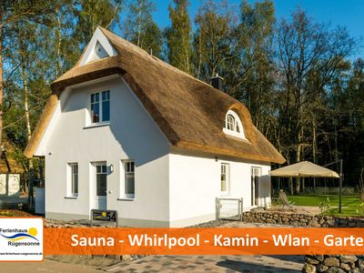 Photo for Exclusive thatched cottage just minutes to the beach - fireplace, sauna, whirlpool