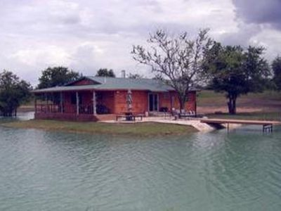 Photo for Your own private lakefront log cabin on a 970 acre ranch.