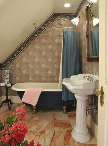 Each bath has claw-foot tub with shower and marble floor