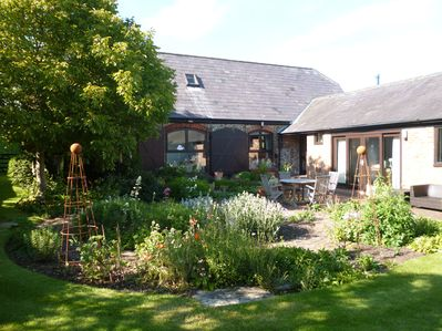 The front garden is a sun trap - a lovely place to sit or share a meal.
