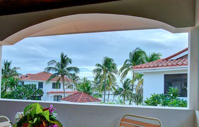 Photo for Ocean view condo with amazing view, close to town, shared pool, housekeeping