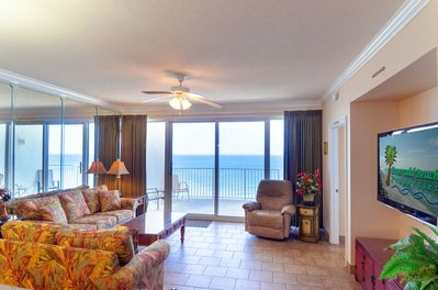 Ocean views from every angle!  This amazing wrap around condo is large enough for everyone in your group to have plenty of room to relax and enjoy a perfect beach vacation!