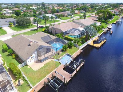 Photo for New Listing, SW Cape Coral Pool Home on Gulf Access Canal, Outdoor Kitchen, Bikes, WIFI, & Parking